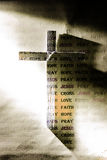Cross of Jesus and word. In warm light royalty free stock photography
