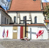 Cross of Katyn placed on the square in front of the church St. G Stock Images