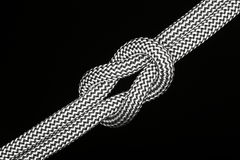 Cross knot on black ground Royalty Free Stock Images