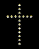 Cross laid out candles. On a black background Royalty Free Stock Photo