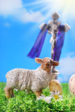The cross and  lamb as symbol of easter. Jesus Christ on the cross and lamb figurine against blue sky as symbol of easter Royalty Free Stock Photography