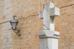 Cross and lammpost. Stock Photos