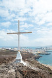 Cross with Las Palmas (1). Christian Cross on Hill with Las Palmas, Gran Canaria in distance Royalty Free Stock Images