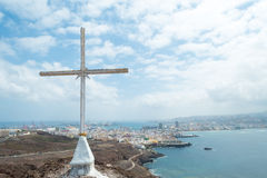 Cross with Las Palmas (2). Christian Cross on Hill with Las Palmas, Gran Canaria in distance Royalty Free Stock Images