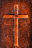 Cross on leather. Cross symbol on a brown leather texture Royalty Free Stock Images