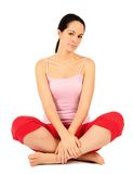 Cross legged. Relaxed young woman sat cross legged on floor Royalty Free Stock Photography