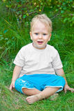 Cross-legged little boy Stock Photo