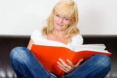 Cross legged reading Stock Photography