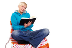 Cross-legged reading Stock Image