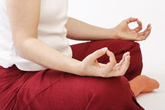 Cross legged sideways. Lady sitting cross legged sideways in meditation II Royalty Free Stock Photos
