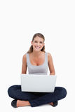 Cross-legged woman using a notebook Royalty Free Stock Photography