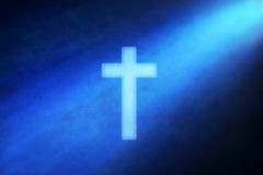 Cross In The Light Background. A cross with a shaft of light in the background royalty free stock images