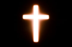 Cross. Light of cross in the dark background stock photos