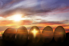 Cross light in the row golden egg. At sunset stock images
