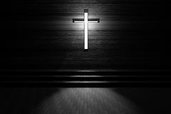 Cross with light shafts. Faith symbol.abstract light of cross religion symbol.cross at the church. Stock Photos