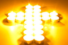 Cross of lighted candles. Christian cross of lighted candles stock images