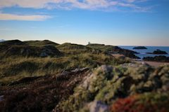 The cross and the lighthouse in the background royalty free stock images