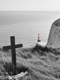 Cross and lighthouse at Beachy Head, United Kingdom stock photos