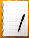 Note book and black pen Stock Photo