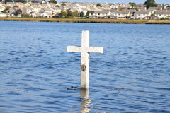 Cross in Lough Atalia, Galway, Ireland. Cross in Lough Atalia in Galway, Ireland during high tide Royalty Free Stock Images