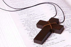 Cross lying inside the bible Royalty Free Stock Photo