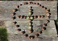 Cross Made of Acorns Encircled Royalty Free Stock Photos