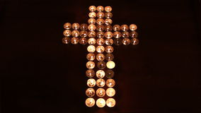 Cross made of candles stock footage