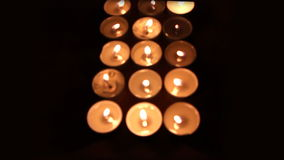 Cross made of candles stock video footage