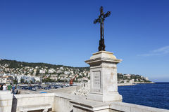 The cross made of iron at the sea coast in Nice Royalty Free Stock Photography