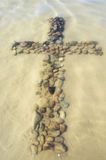 Cross made of rocks underwater Royalty Free Stock Images