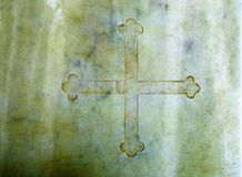 Cross in marble. Color structure rock background. Royalty Free Stock Images