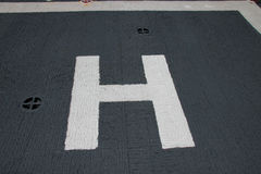 Cross mark and H letter on observation zone Stock Photography