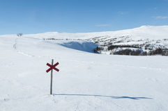 Cross mark and ski track Stock Image