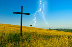 Cross on meadow Stock Photography