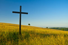 Cross on meadow Royalty Free Stock Image