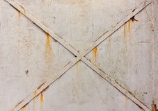 Cross on metal doors, a background of gray, cracked paint,  rust Royalty Free Stock Images