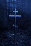 Cross in the misty forest Royalty Free Stock Photo