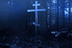 Cross in the misty forest Royalty Free Stock Images