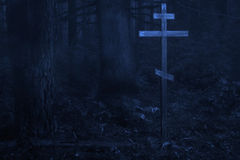 Cross in the misty forest Stock Photography