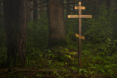 Cross in the misty forest Royalty Free Stock Photos