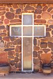 Cross with misty icons in a natural stone wall Royalty Free Stock Photos