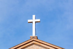 Cross on Modern Christian Church Under Blue Sky Stock Photography
