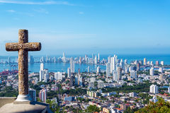 Cross and Modern City. View of the modern part of Cartagena, Colombia with a stone cross in the foreground Royalty Free Stock Images