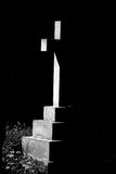 Cross in Mono. Strong sunlight lit cross to form almost abstract image Royalty Free Stock Photo