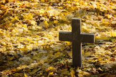 A cross monument in a cemetery Stock Image