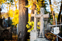 A cross monument in a cemetery Stock Photography