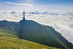 Caraiman Heroes Cross Monument in Bucegi Mountains, Romania. The Heroes' Cross is a monument built between 1926 and 1928 on Caraiman Peak at an altitude of 2,291 stock photos