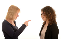 Angry mother. An angry mother pointing with finger at her daughter Stock Image
