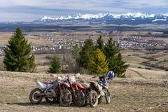 Cross motorbikes in country. KLIN, SLOVAKIA - MARCH 17: Parked cross motorbikes at region Orava on March 17, 2019 in Klin stock photos