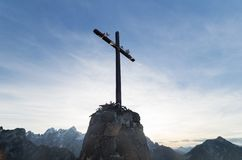 The cross on Mount Lussari. The cross on the top of Mount Lussari on the Alps of Friuli near Tarvisio Stock Images